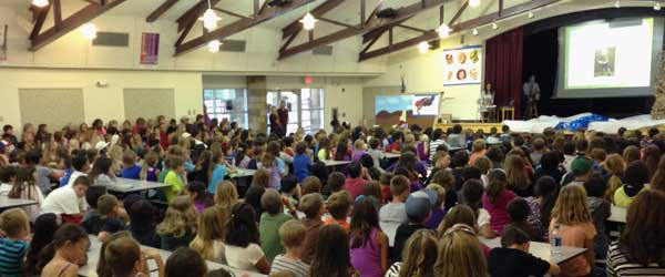 Shoba speaks before a packed auditorium at Cole Elementary in Murrieta, California